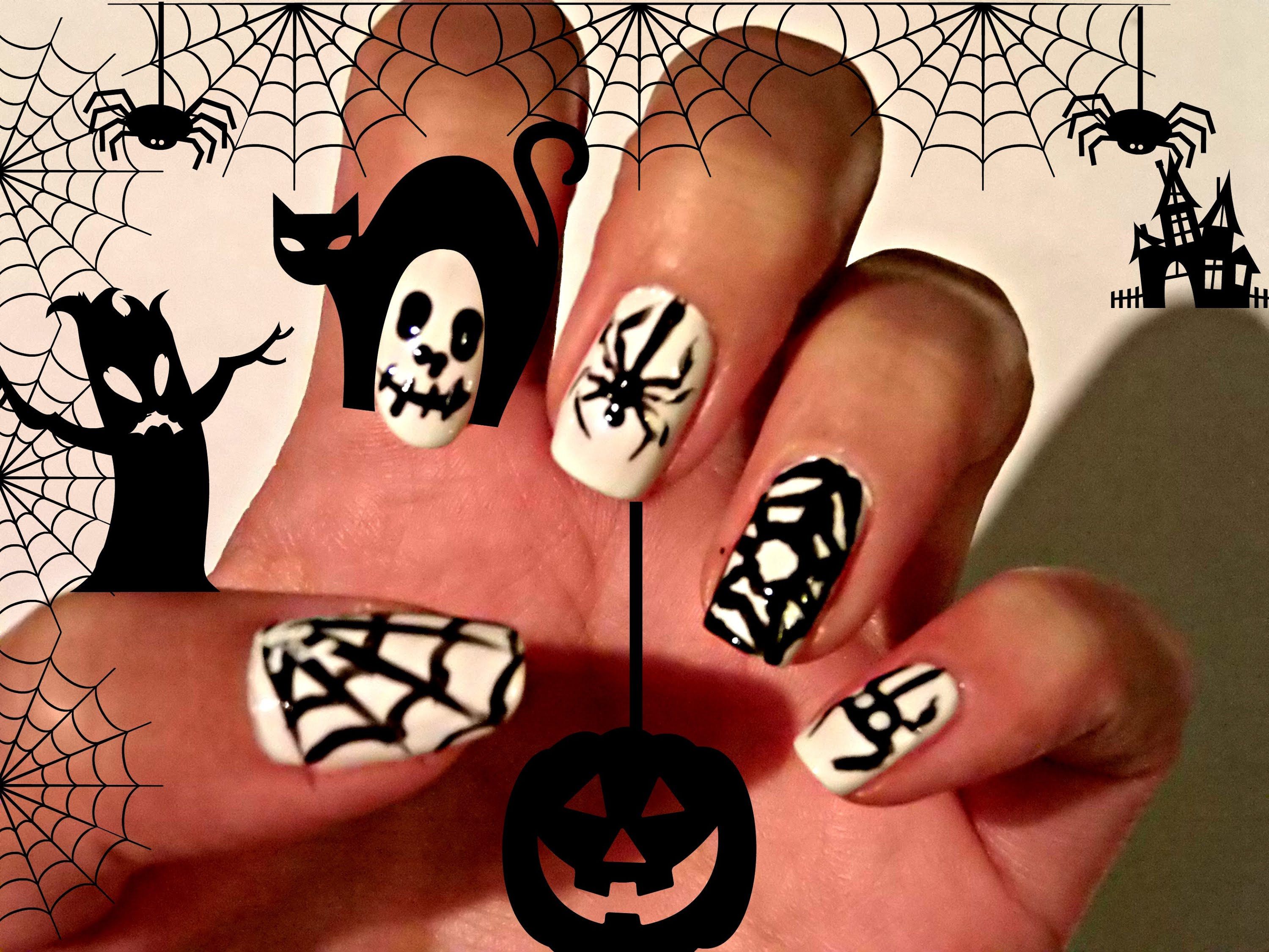halloween nails with spider web design